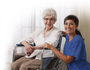 Elderly woman in wheelchair with home health aide